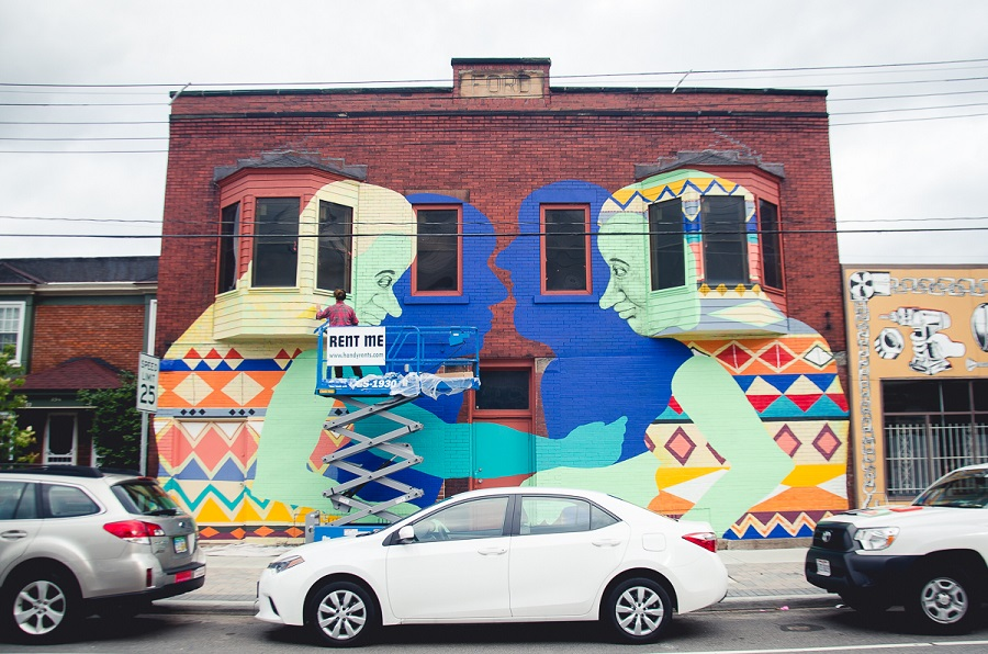 colorful mural on a red brick building