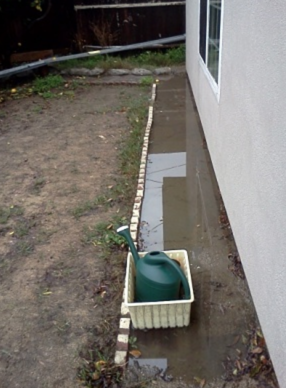 Plant bed trapping water near foundation
