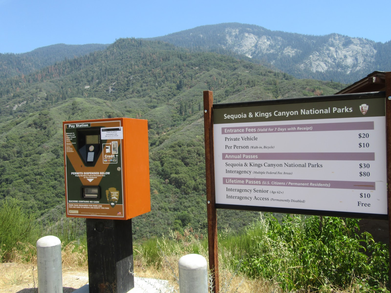Sequoia National Park entrance booth and sign while climbing by bike on Mineral King Road