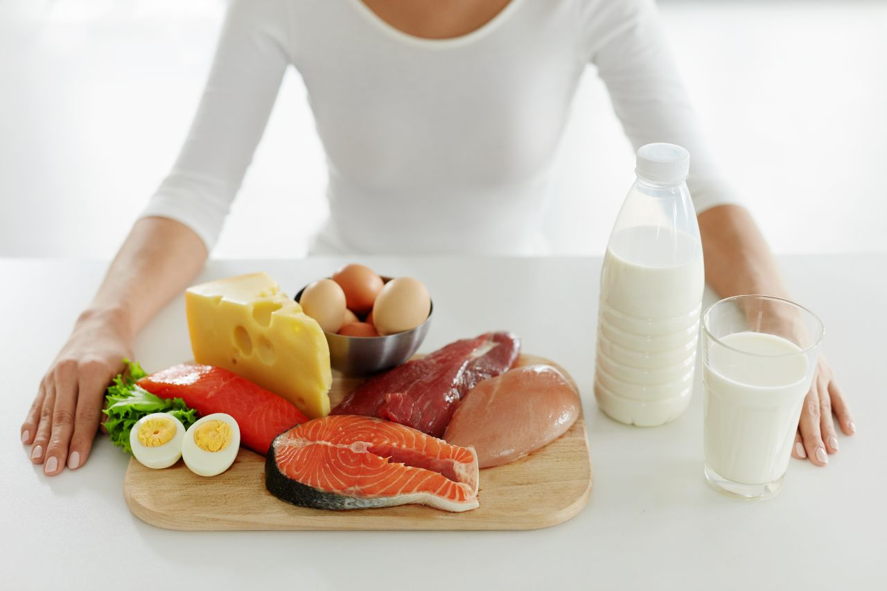 Protein for women: Various high-protein foods on a cutting board
