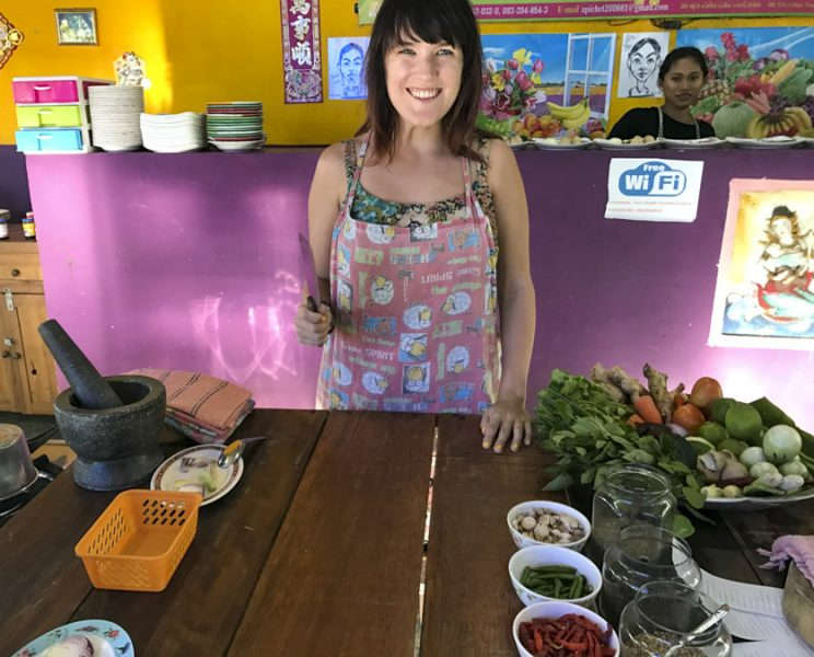 Lora taking a cooking class in Thailand