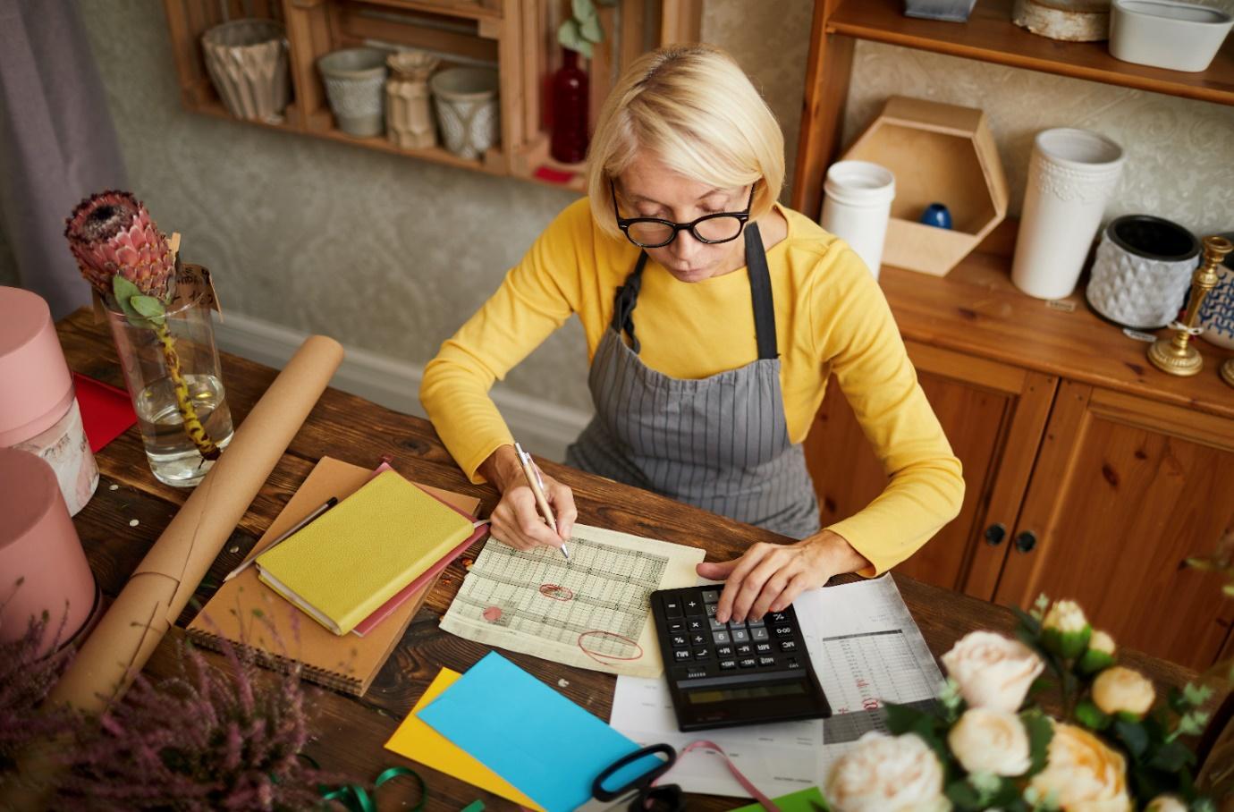 Female entrepreneur working in her home
