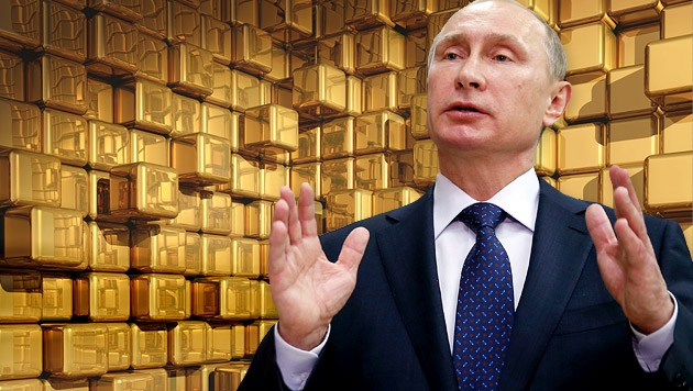 Vladimir Poutine au milieu des lingots d'or