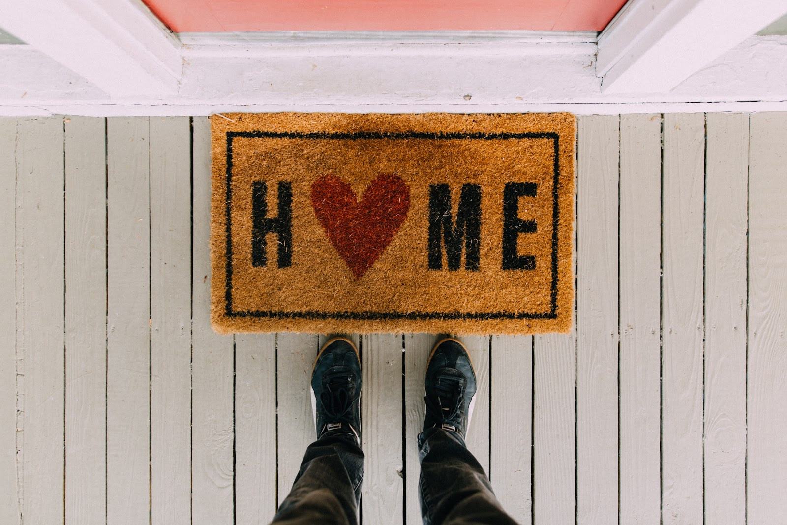 door mat with the word home on, things to save and splurge within your home