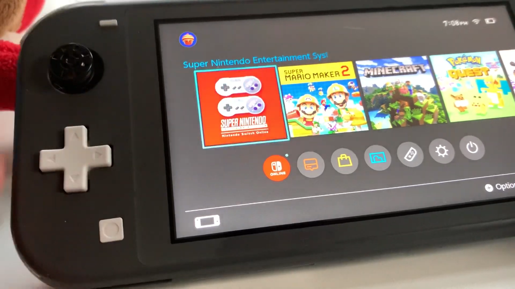 A Nintendo Switch Lite showing the SNES App