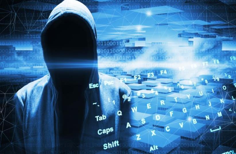 Hacker in a hood (photo credit: INGIMAGE)
