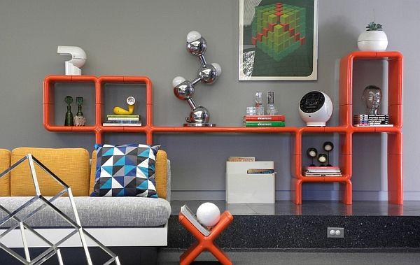 Màu sơn tường trầm đậm nhưng kết hợp với màu sắc nội thất tạo nên sự độc đáo