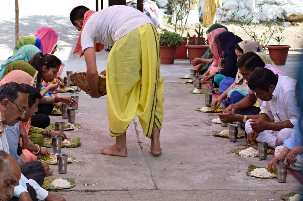 Indian people having food together
