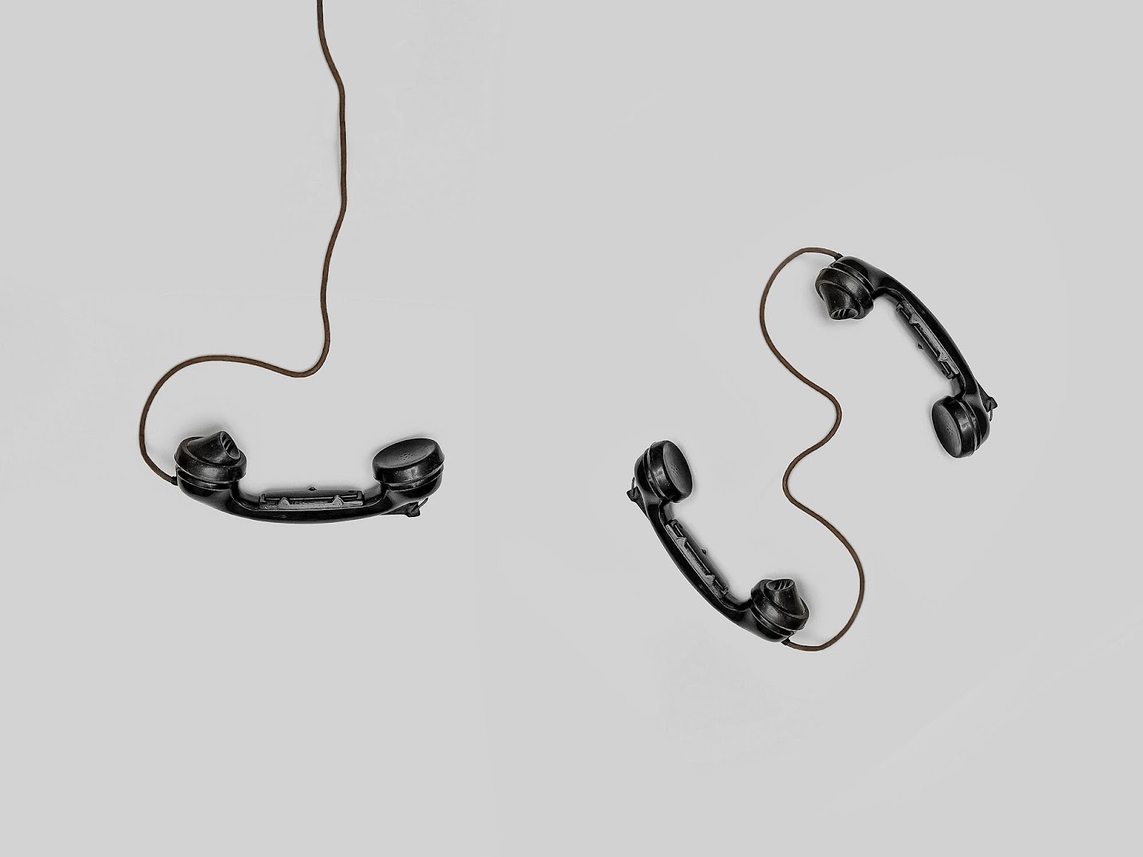 three-black-handset-toy telephones internal communications plan