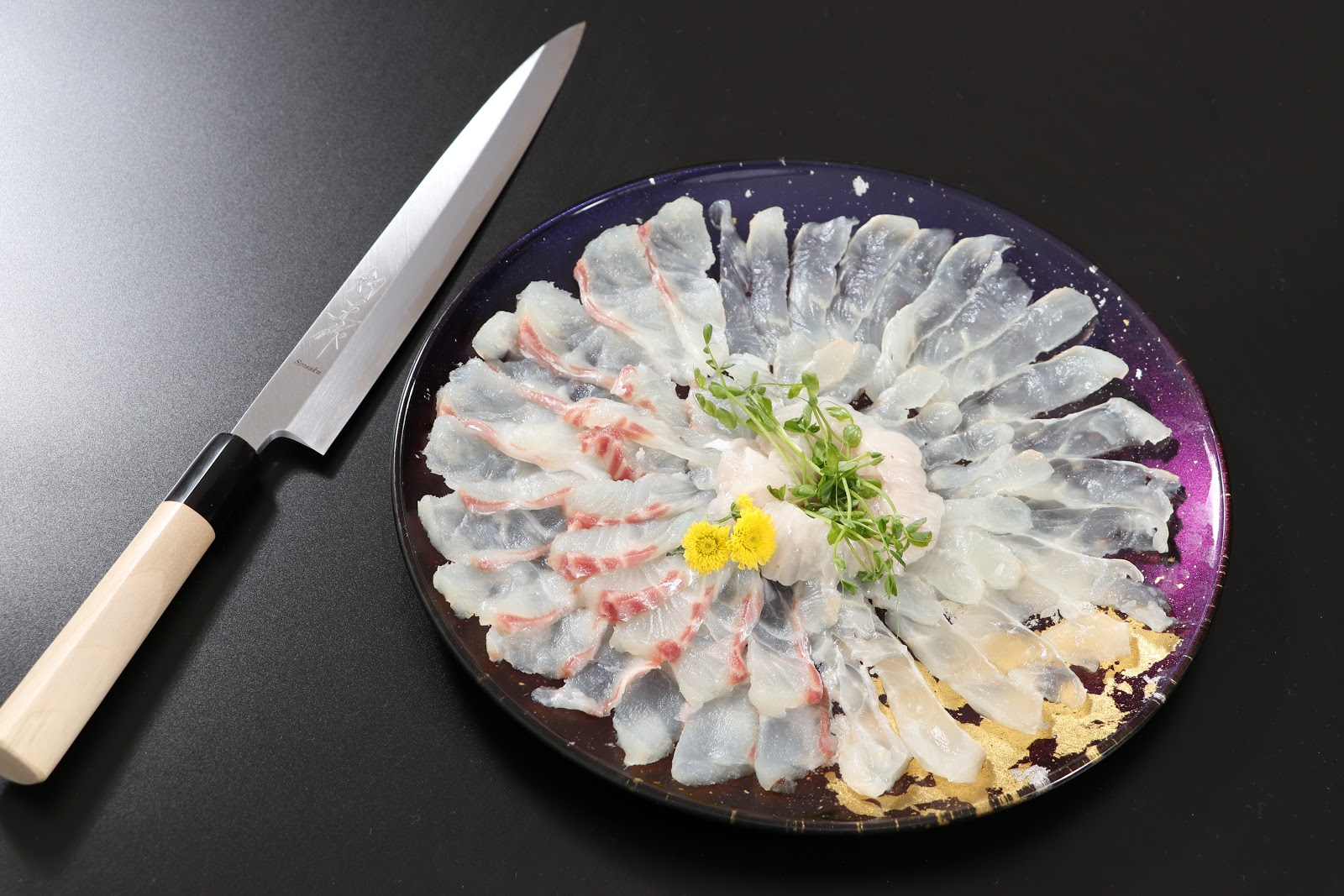 Usuzukuri (thinly sliced Hirame and Tai), presented on Syosaku Urushi Glass Flat Dinner Plate Majestic Blue
