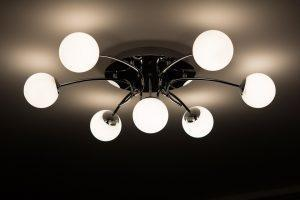 a simple and modern chandelier with a silver base