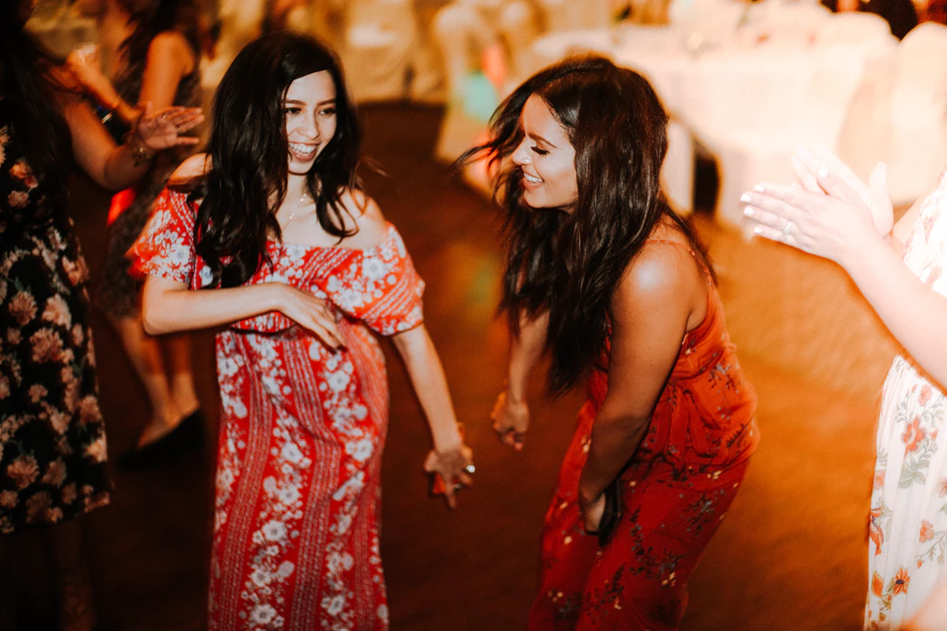 Women Dancing at a Wedding Reception