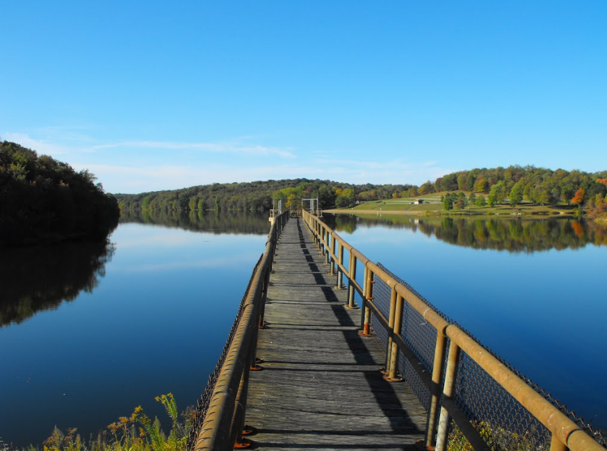first-person perspective of a bridge over a lake at Barkcamp State Park