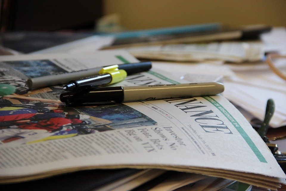 Cluttered Desk with Papers and Pens