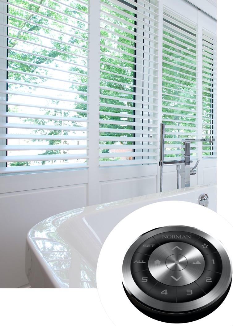 A white tub sitting next to a window  Description automatically generated