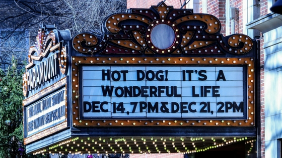 Movie marquee with text saying Hot Dog! It's a Wonderful Life