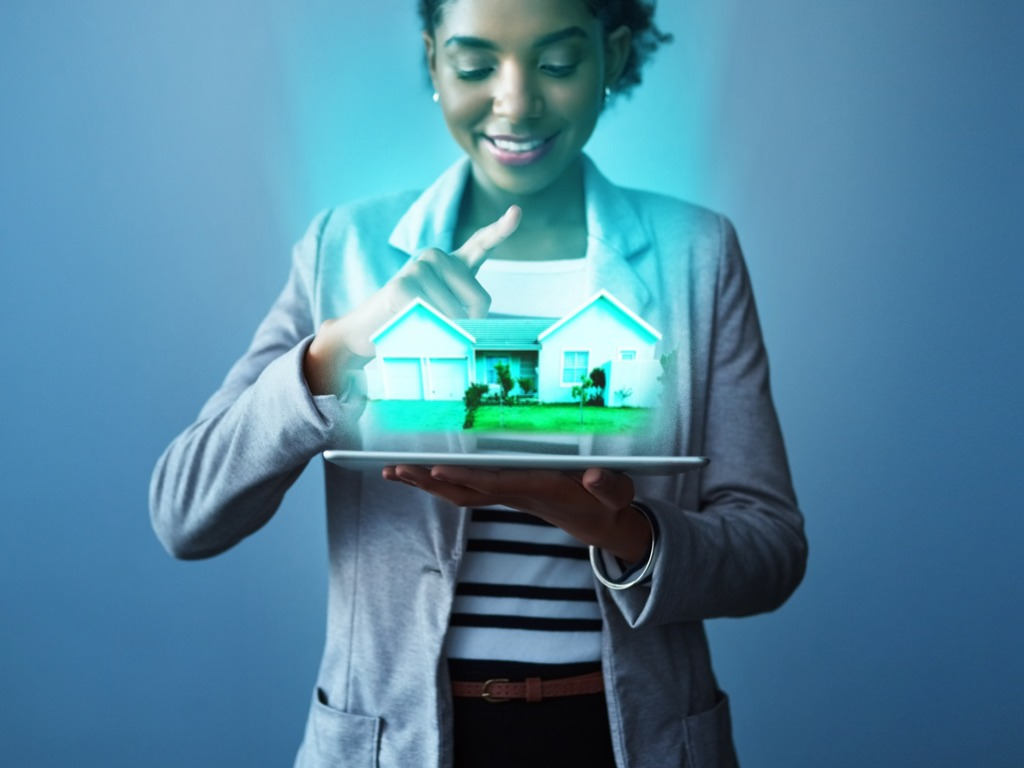 women holding virtual house projected out of tablet