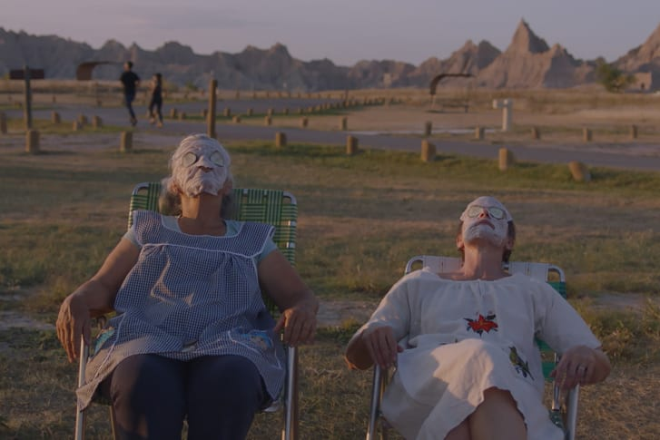 """Linda May and Fern (Frances McDormand) recreate a spa experience between shifts at a camp site in """"Nomadland."""""""