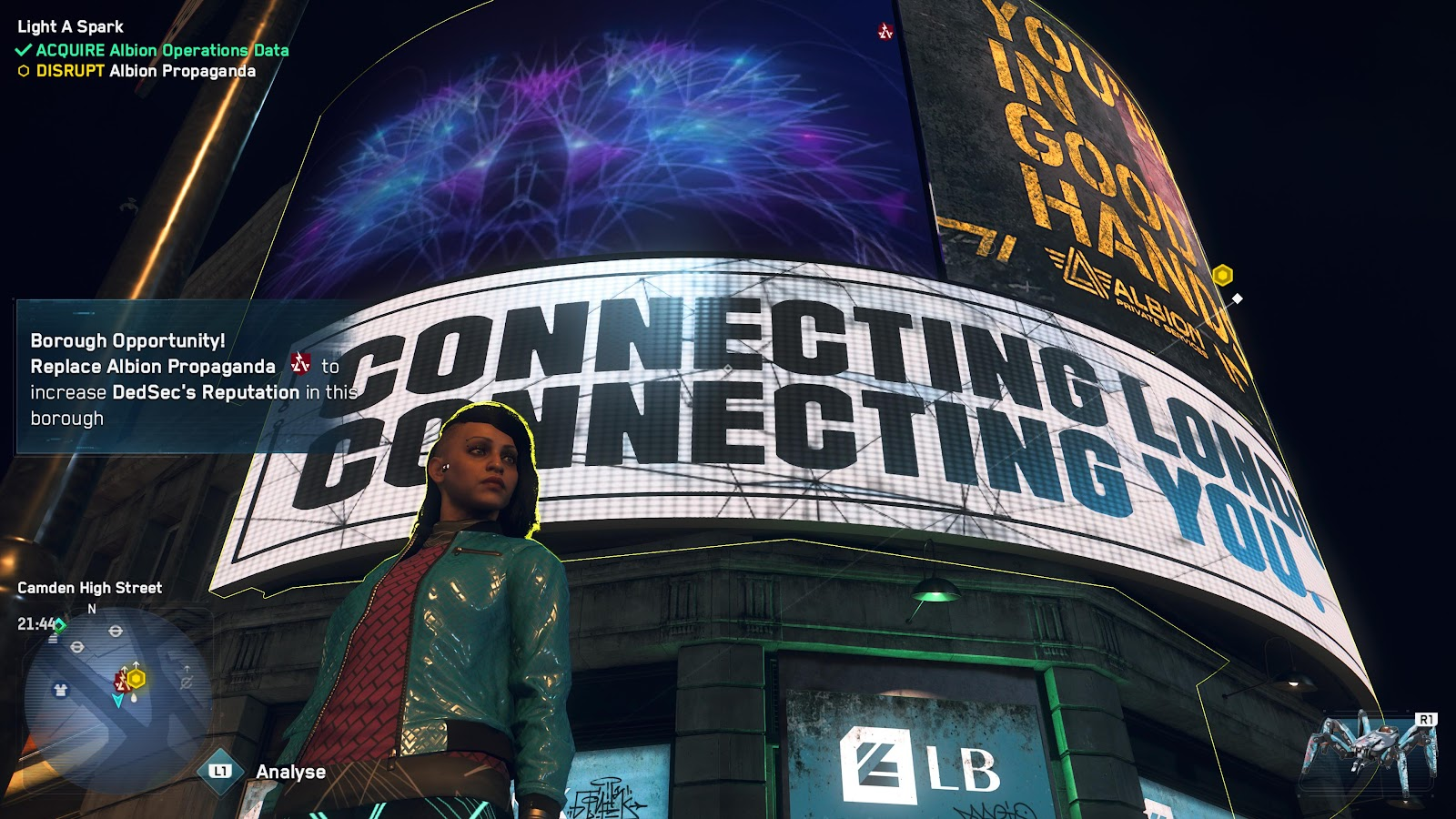 Watch Dogs character standing in front of an Albion propaganda billboard.