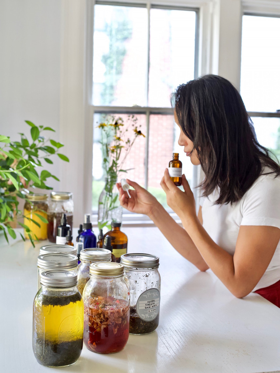 The Herbal Academy - the girl is smelling the herbal