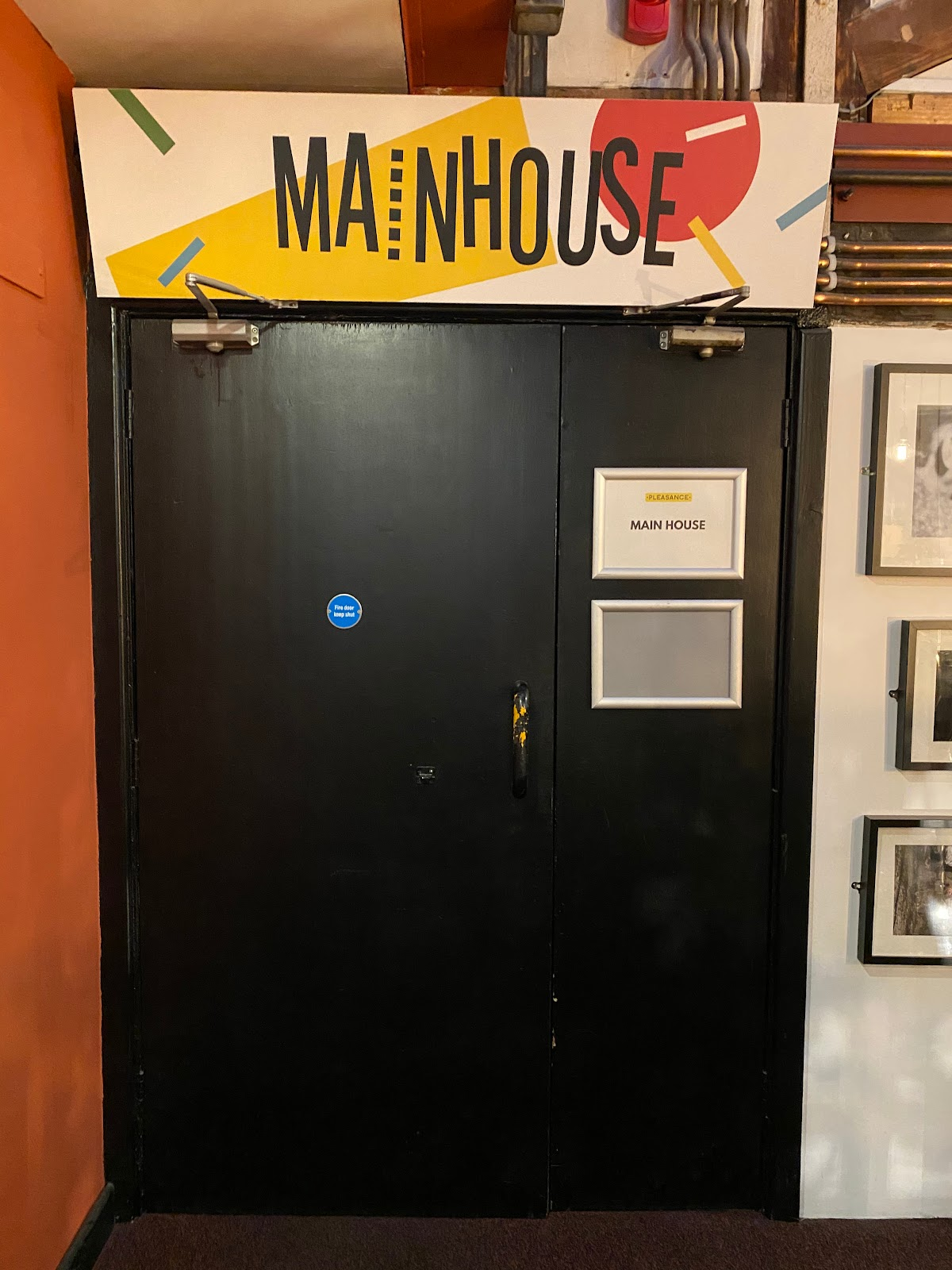 """There is a sign above the door that says """"Main House"""""""