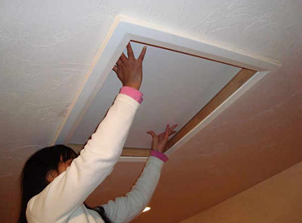 lady opening attic hatch