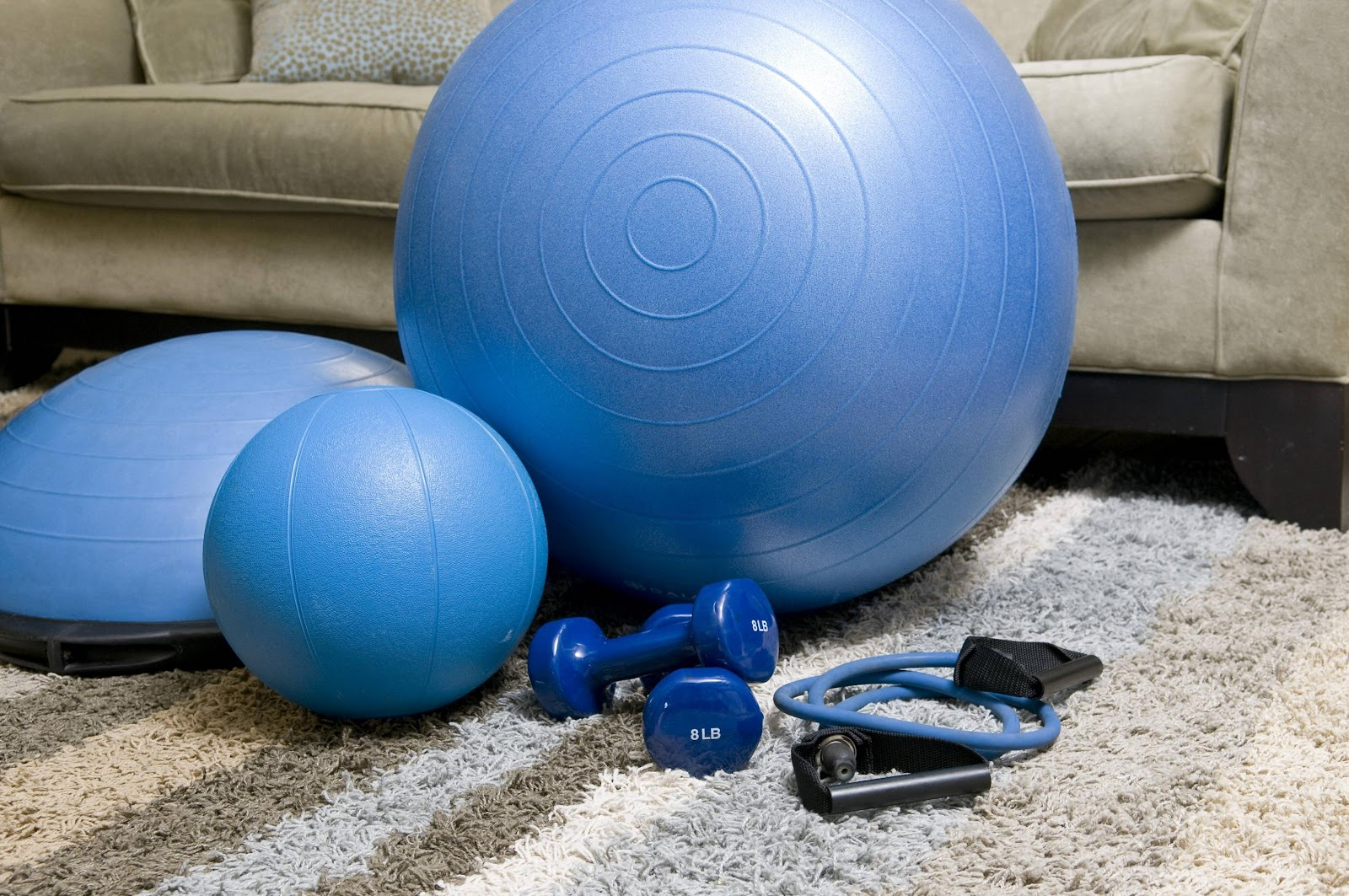 Exercise equipment next to the couch