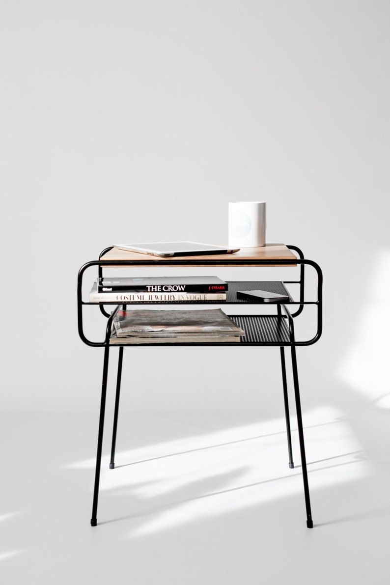 small black wired metal table