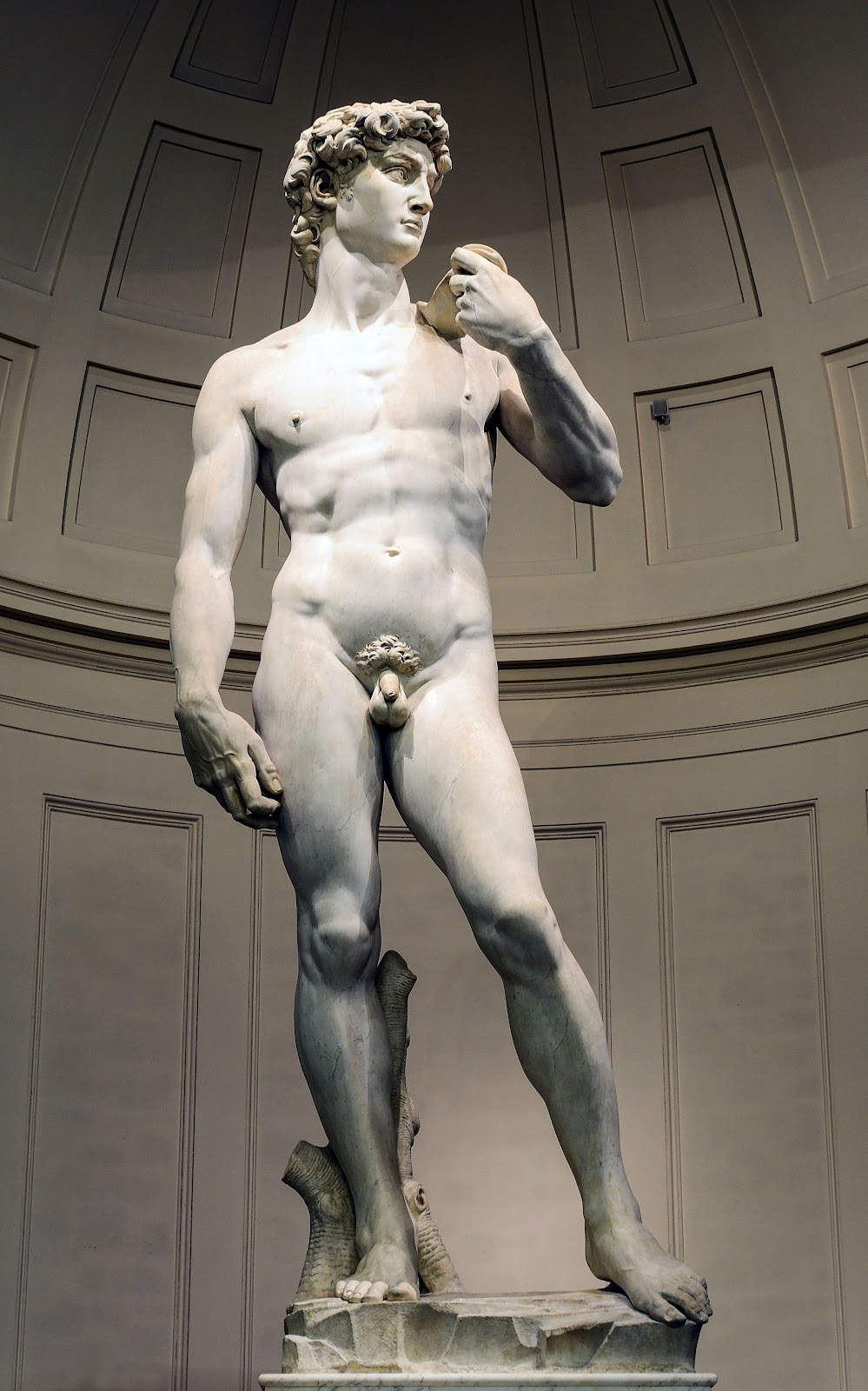 Michelangelo's The David, a towering marble sculpture of a nude David before his battle with Goliath.