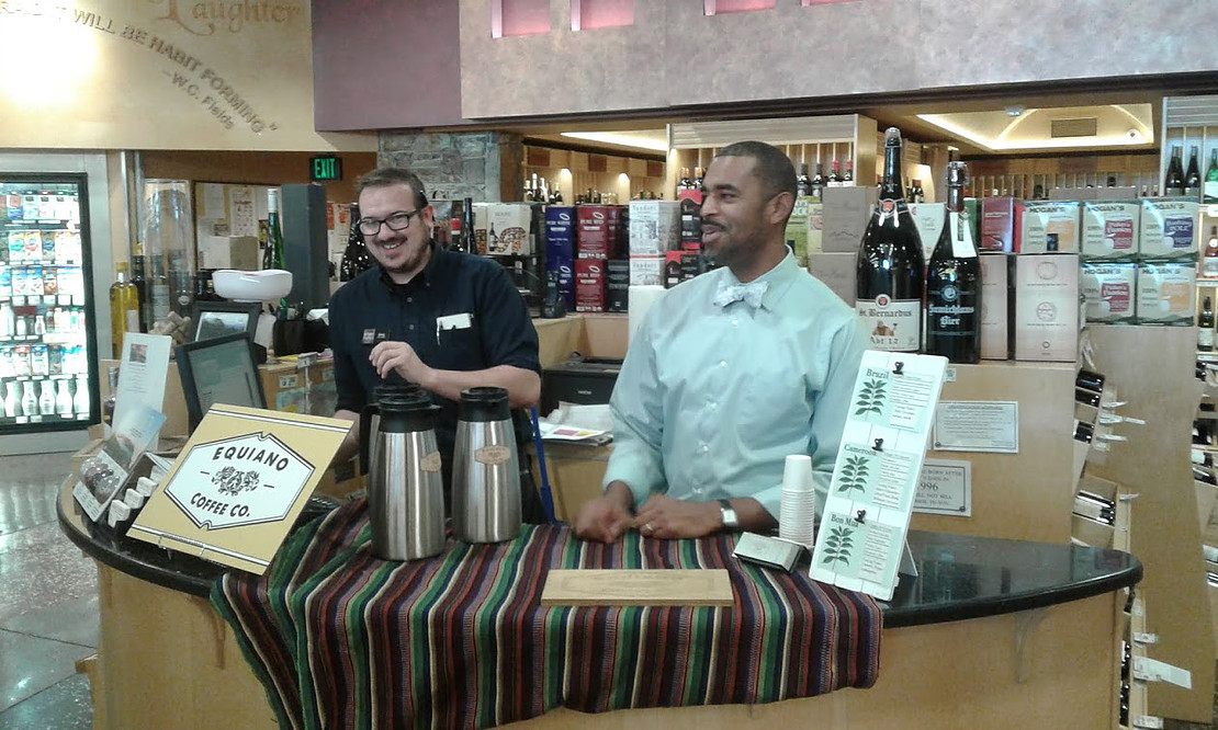 Okon Udosenata sampling out coffees from Equiano Coffee Company inside Market of Choice on Willamette Street in Eugene, Oregon.