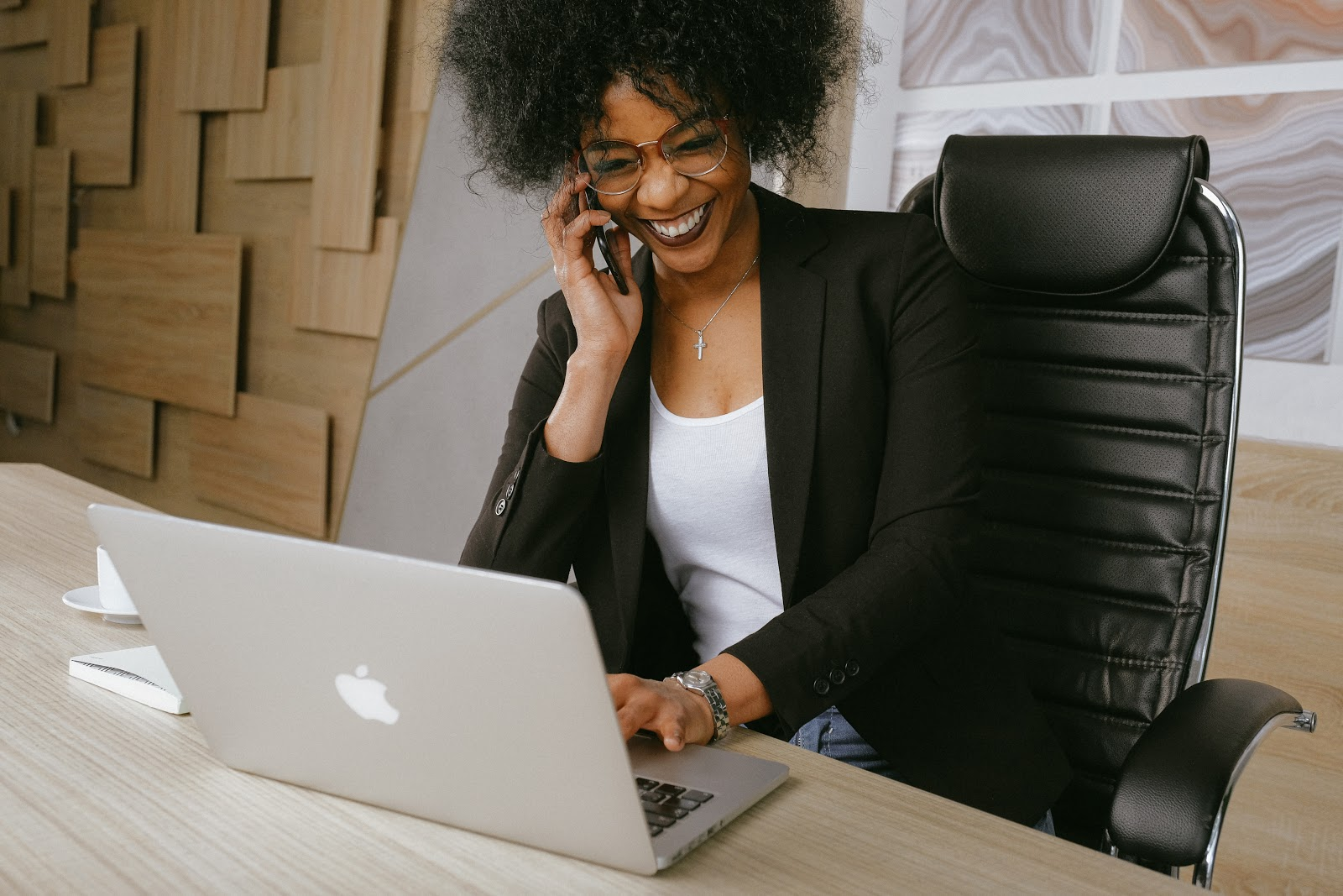 A lady making phone calls in her office