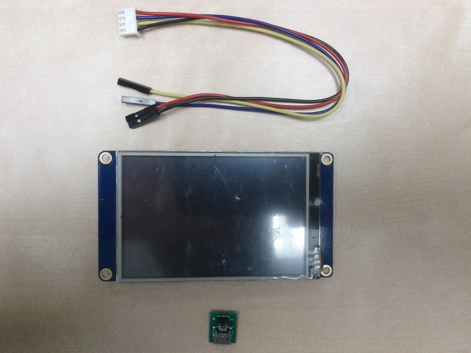 Nextion package and the contents. Screen, wire harness, and USB power connecor