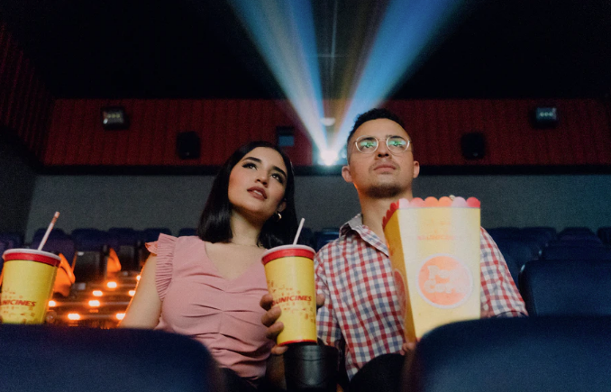 Two people attending movie theater