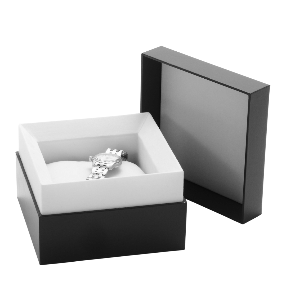 Photo of a steel watch safe inside a watch box with a cushion and a lid.