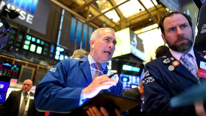 Traders work during the opening bell at the New York Stock Exchange (NYSE) on March 5, 2020 at Wall Street in New York City.