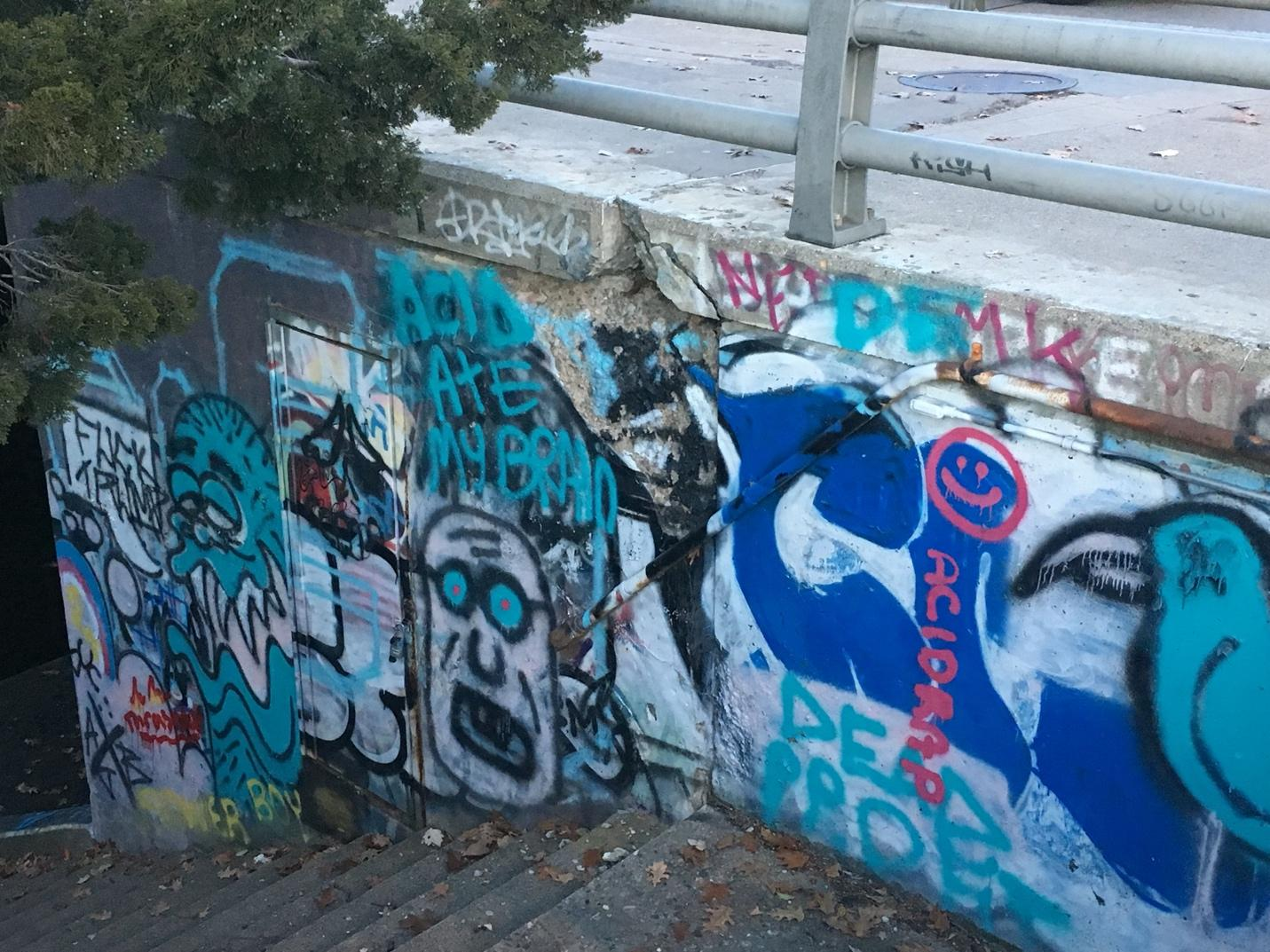 A picture containing graffiti, outdoor, painted Description automatically generated