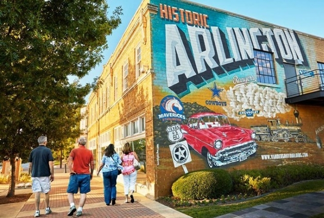 "Locals walk past ""Historic Arlington"" mural in Texas"