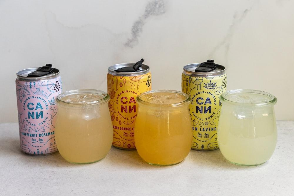 3 clear glass jars with yellow liquid