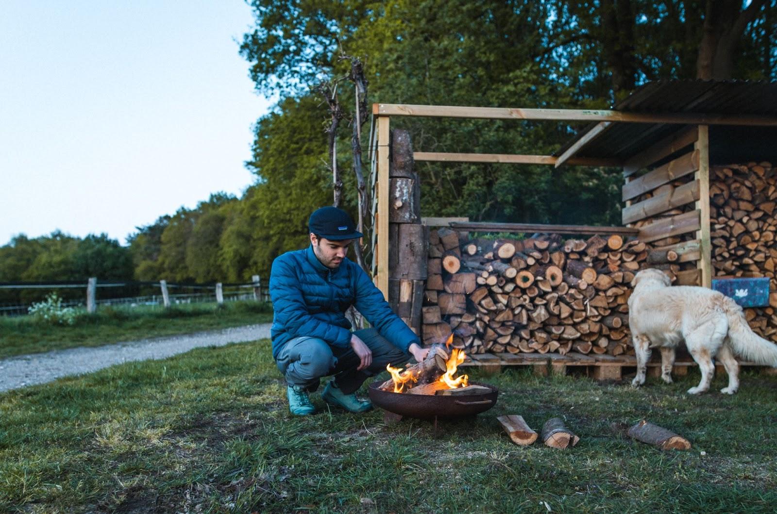 Man lighting fire outdoor life hacks Campspace