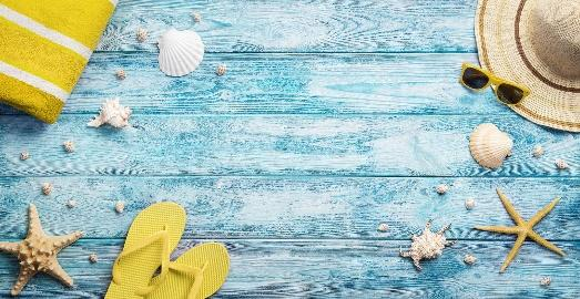 Summer accessories on a blue weathered table