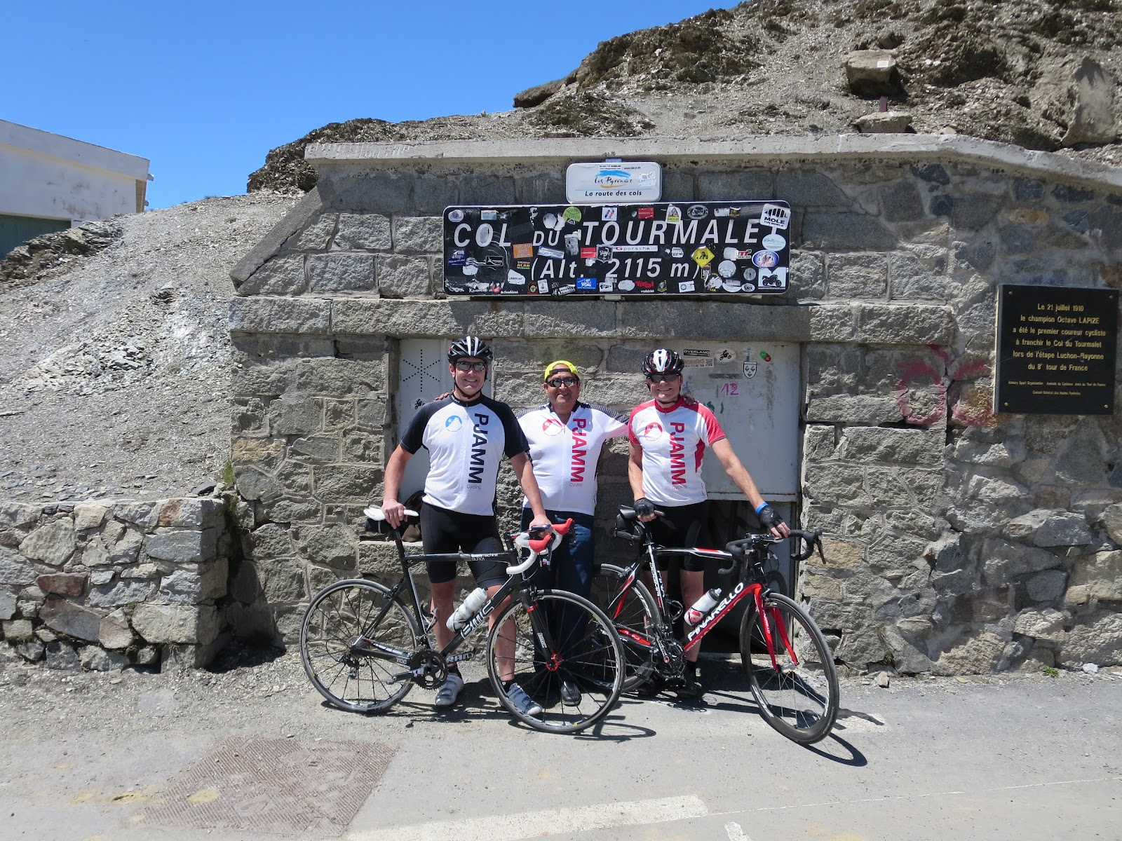 Col du Tourmalet cycling trip summer 2013 - cyclists at col with col sign and Le Geant