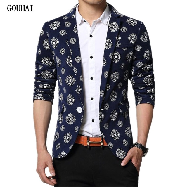 man in white shirt and patterned blazer