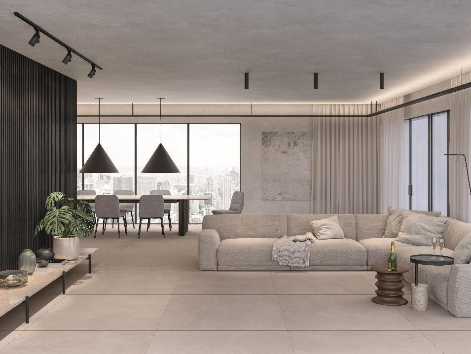 Sala com sofá cinza, piso porcelanato cinza, paredes cinza, sala de estar integrado com sala de jantar e mesa com 8 cadeiras e luminárias pendentes.