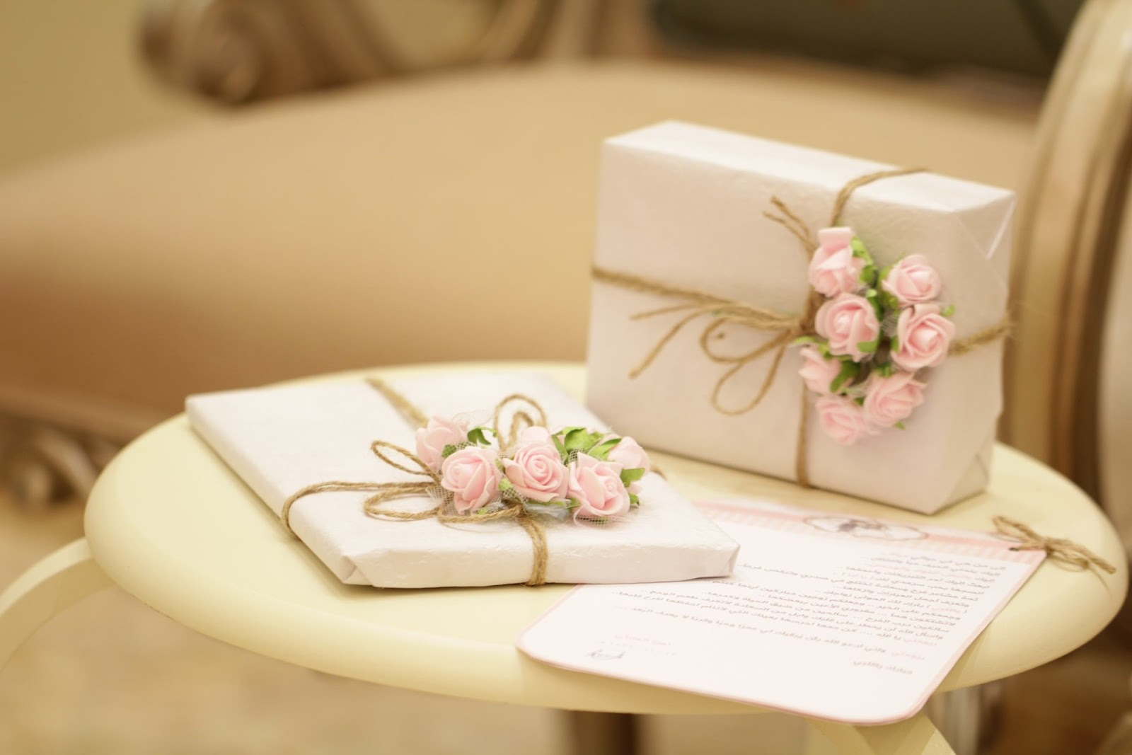 Ways to personalise a wedding gift; two well-wrapped gifts placed on a white round table