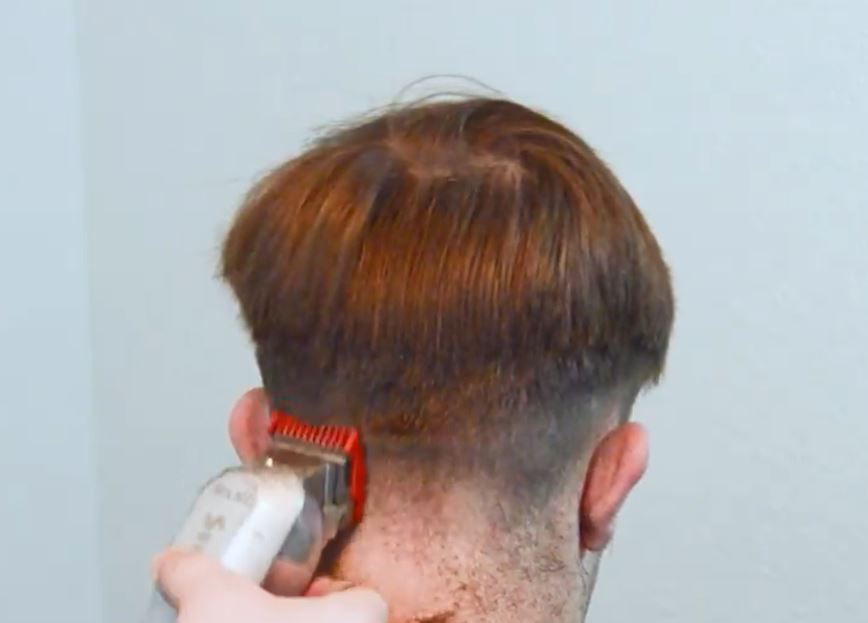man head with clippers