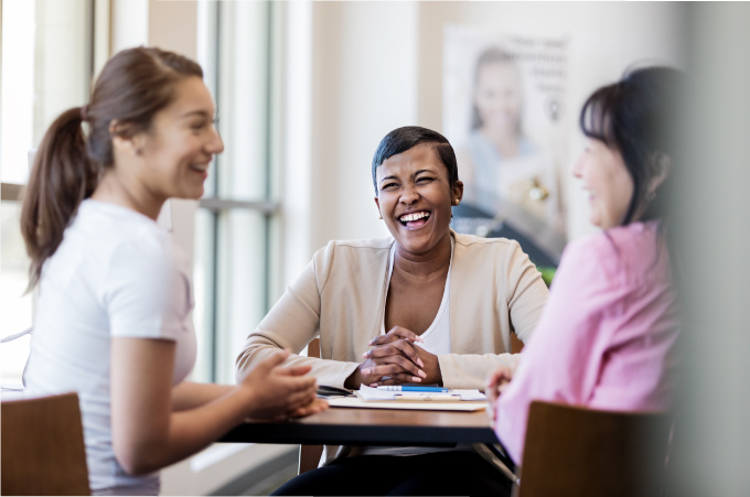 Two women discussing finances with a bank.