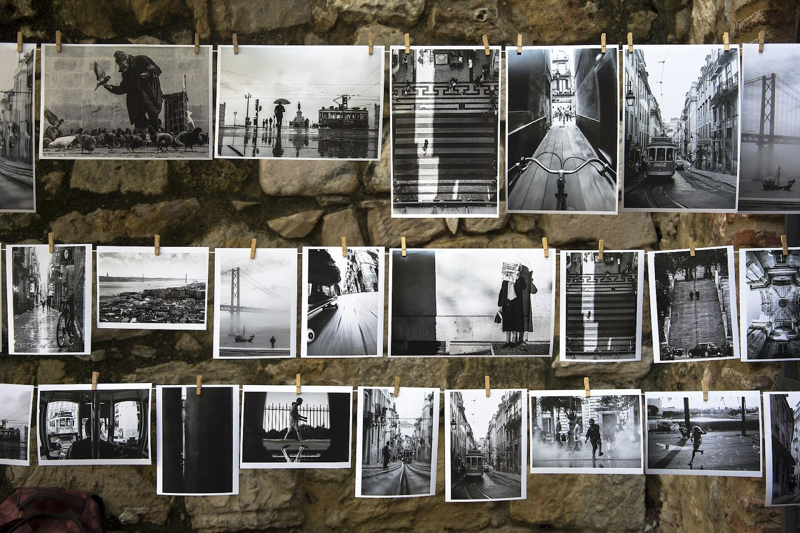black and white photos displayed along clothes line