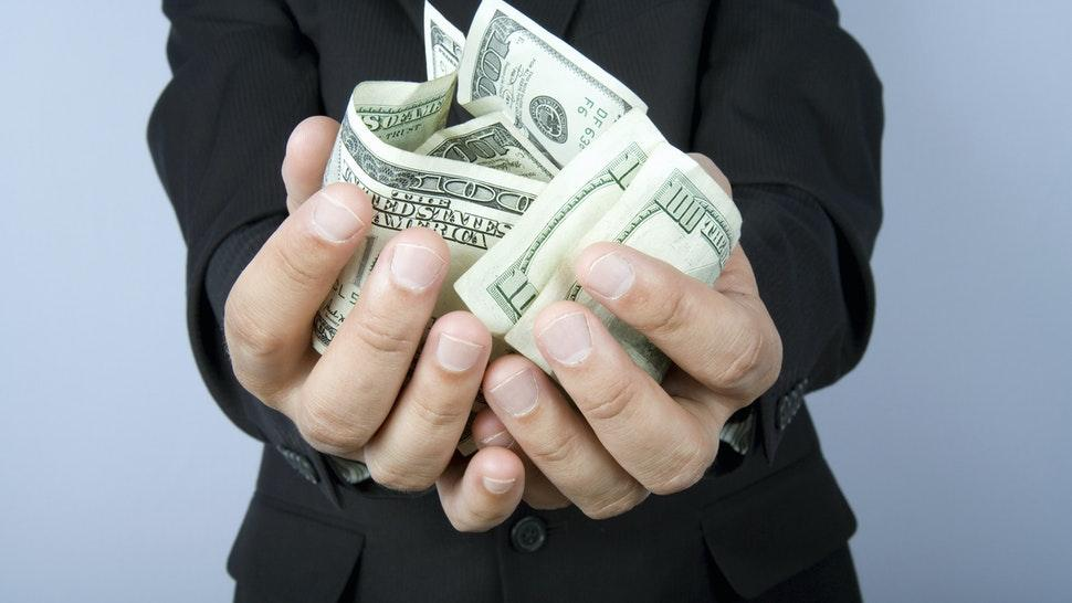 Hands with cash