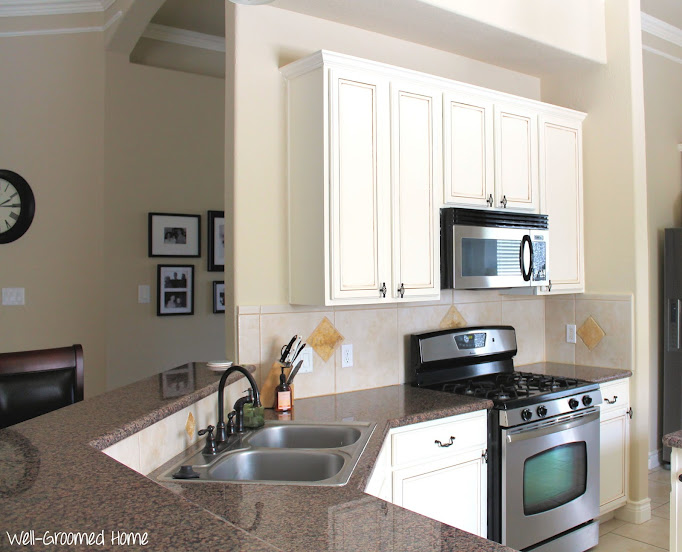 Painted kitchen cabinets chalk paint well groomed home for White kitchen cabinets turning yellow
