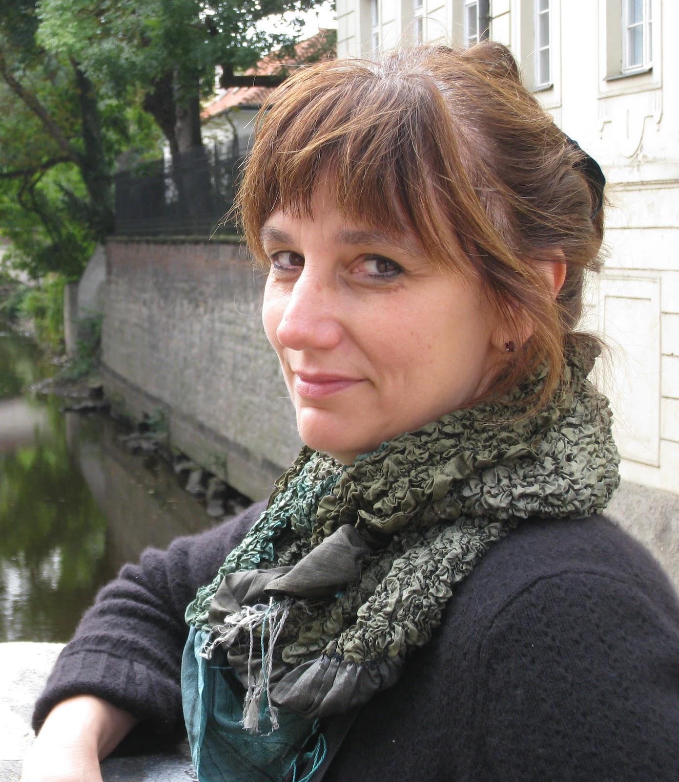 Professional author photo of Mira Bartók, a brown-haired, white-skinned woman wearing a scarf.